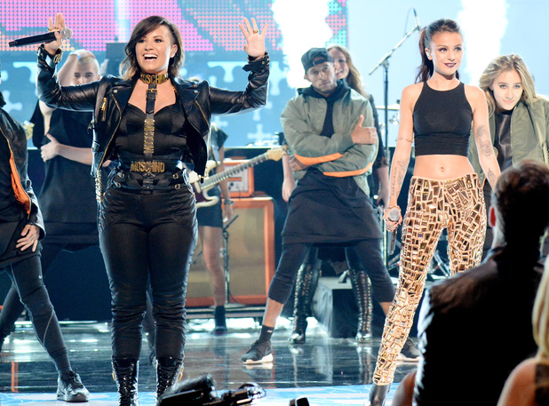 Demi Lovato and Cher Lloyd perform at the Teen Choice Awards 2014 in Los Angeles, America - 10 August 2014