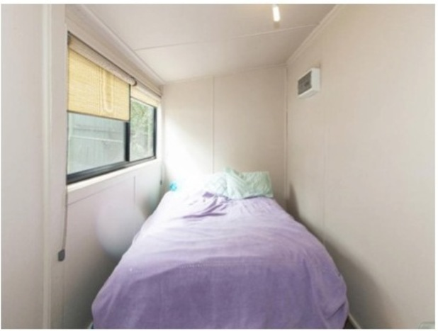 Tiny room with bed, taken from Terrible Estate Agents