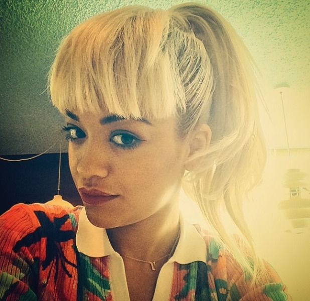 Rita Ora works a bold fringe and high ponytail for Kiis FM with Giuliana Rancic and Ryan Seacrest, 11 August 2014