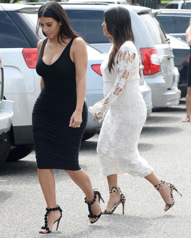 'Keeping Up With The Kardashians' on set filming, Los Angeles, America - 12 Aug 2014 Kim Kardashian and Kourtney Kardashian