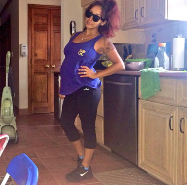 Snooki gets ready for the gym after saying she feels super pregnant, 15 August 2014