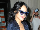 Rihanna shows off flat tum in lace bralet and tiny denim hotpants