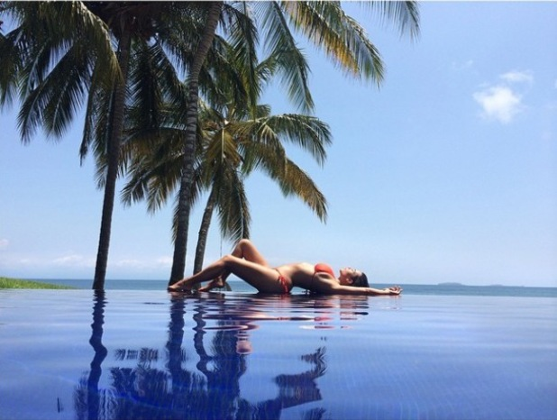 Kim Kardashian reflects on Mexican holiday with pool bikini picture, America - 19 Aug 2014