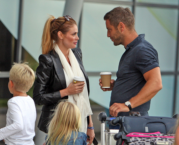 Chloe Sims and Elliott Wright arrive at Southend Airport with their kids after a holiday in Spain, 22 August 2014
