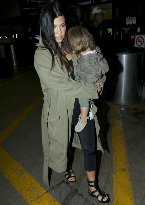 Kourtney Kardashian and her daughter Penelope Disick arrive at Los Angeles International Airport (LAX) - 17 August 2014