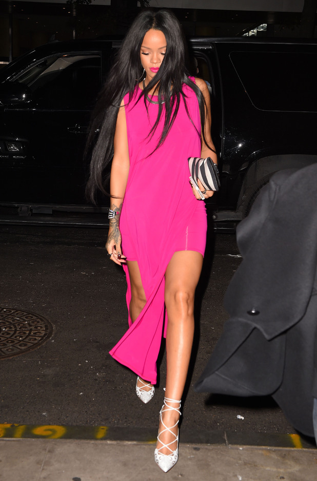 Rihanna wears a hot pink dress while out in New York, America - 18 August 2014