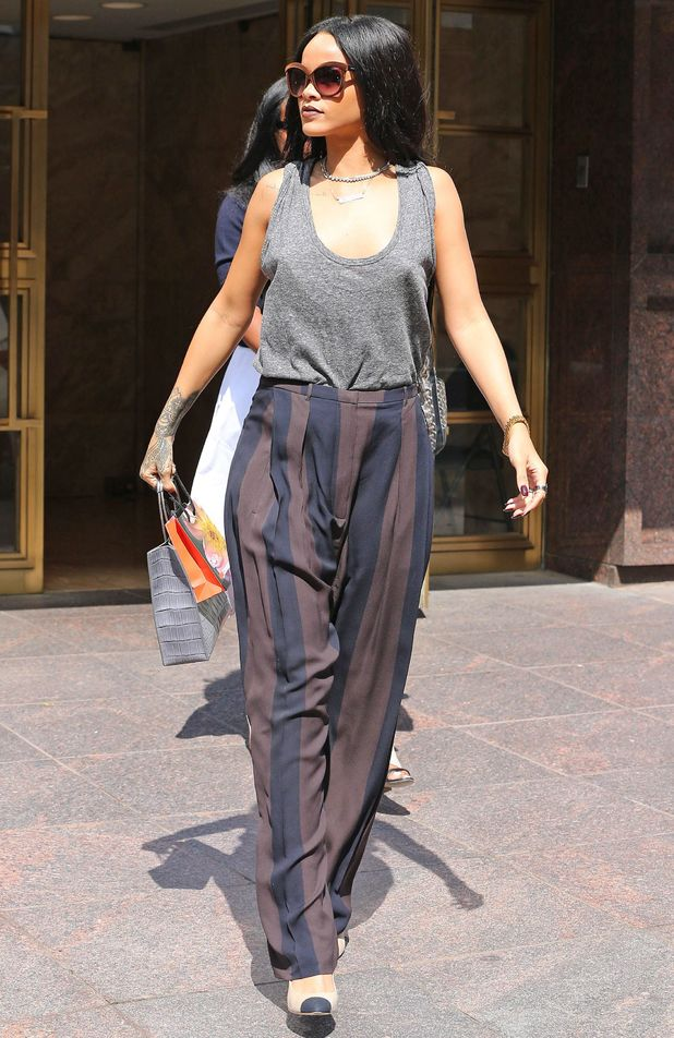 Rihanna wears baggy striped trousers while out in New York, America - 20 August 2014