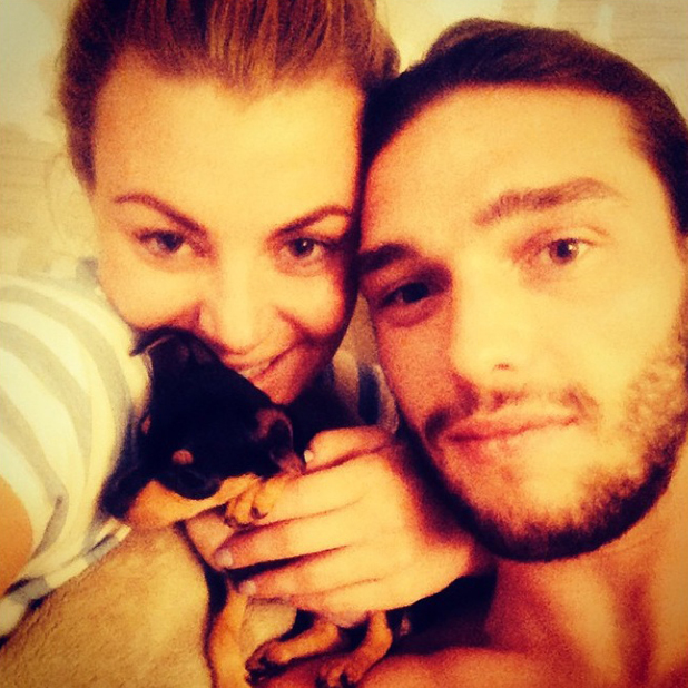 Billi Mucklow and Andy Carroll with their new puppy, 20 August 2014