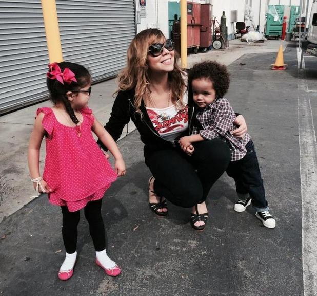Mariah Carey spends quality time with twin children Monroe and Moroccan in New York. (27 August).