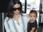 Kim Kardashian's baby North carries tiny handbag through airport