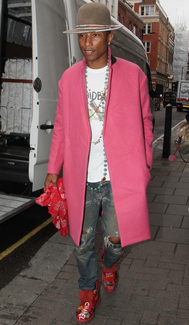 Pharrell Williams, dressed in a long pink blazer, arriving at the Dover Street Market in Mayfair - 2 September 2014