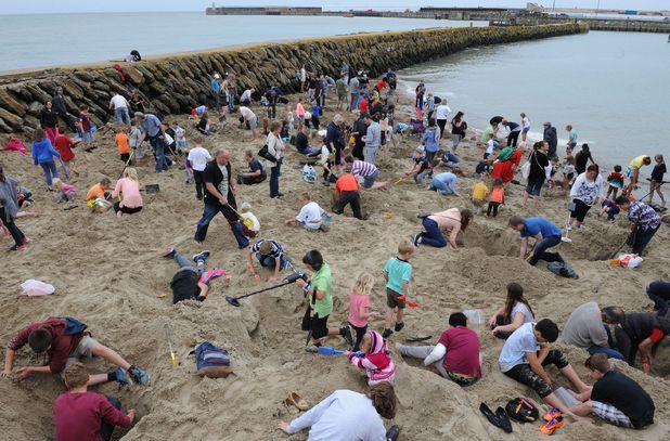 Folkestone Digs: art project sees £10,000 of gold nuggets buried in the sand