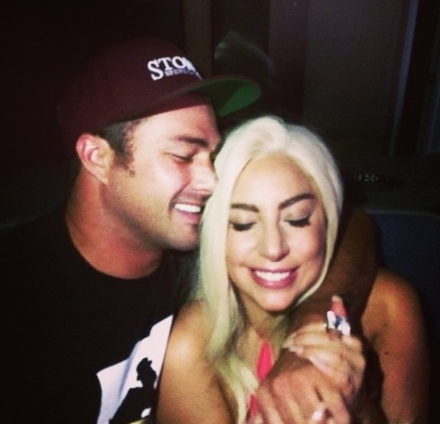 Lady Gaga and boyfriend Taylor Kinney watch American country singer Garth Brooks perform in Chicago (4 September).
