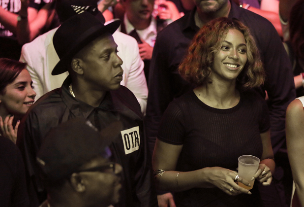 Rapper Jay-Z (L) and singer Beyonce are seen watching Steve Aoki's set during day 2 of the Made in America Festival at Los Angeles Grand Park on August 31, 2014 in Los Angeles, California. (Photo by Chelsea Lauren/WireImage)
