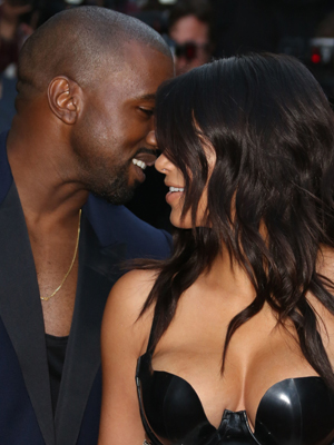 Kim Kardashian (L) and Kanye West attend the GQ Men Of The Year awards in association with Hugo Boss at The Royal Opera House on September 2, 2014 in London, England.