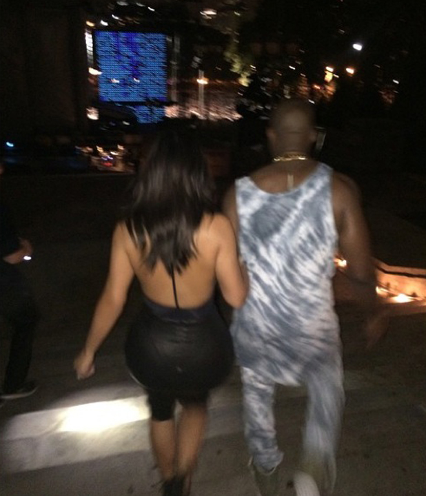 Kim Kardashian and Kanye West at Budweiser Made in America music festival, Philadelphia, 30 August 2014