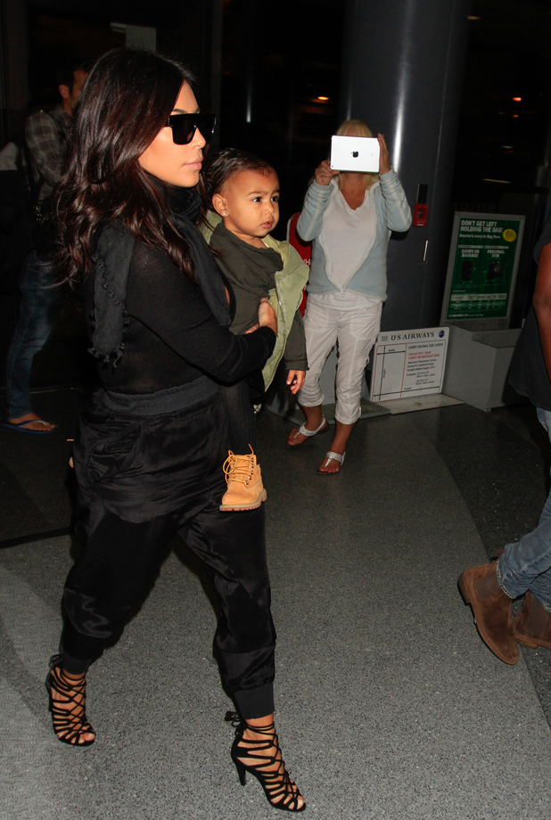 Kim Kardashian and North West are seen at LAX on August 30, 2014 in Los Angeles, California. (Photo by GVK/Bauer-Griffin/GC Images)