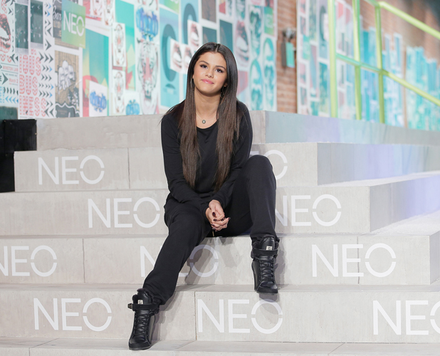 Selena Gomez poses for photos near the runway at Adidas Neo during Mercedes-Benz Fashion Week Spring 2015 at The Waterfront on September 3, 2014 in New York City.