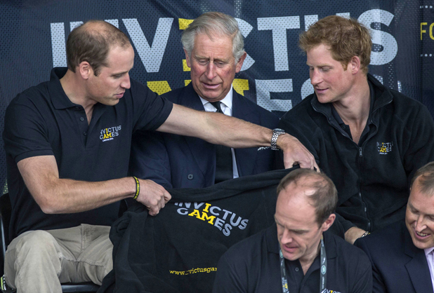 Prince William and Prince Harry with their father Prince Charles at Invictus Games, Lee Valley Athletics Centre, London. 11 Sep 2014