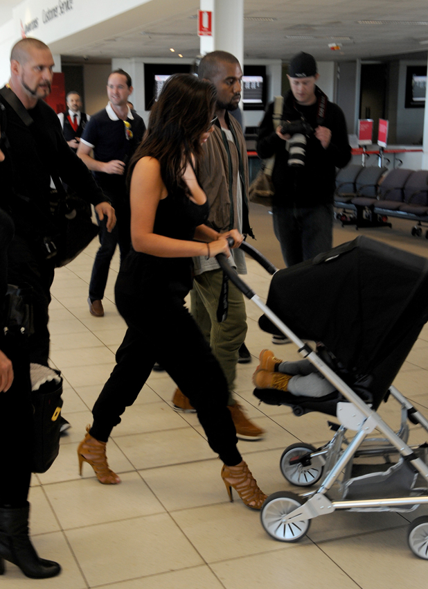 Kim Kardashian and Kanye West, with baby North West, arrive at Adelaide Airport 6 Sep 2014