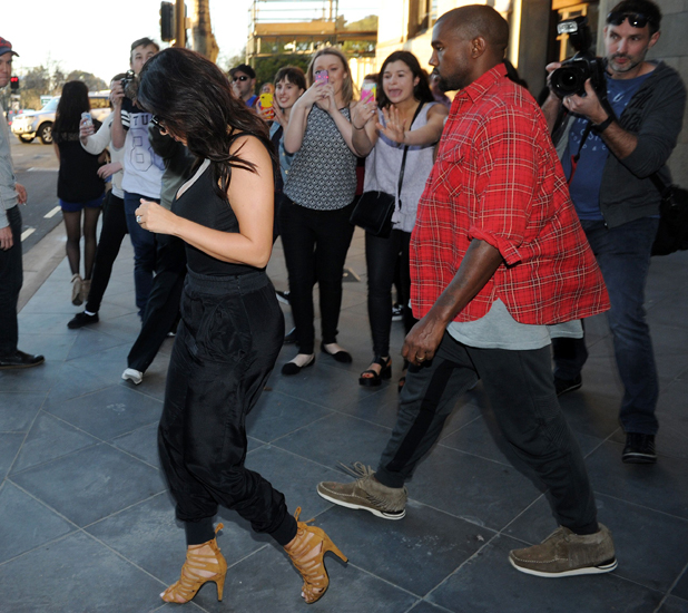 Kim Kardashian and Kanye West leave Jamie's Italian restaurant on King William Street in Adelaide 6 Sep 2014