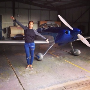 Ferne McCann tries her hand at flying a light aircraft in Essex, September 2014