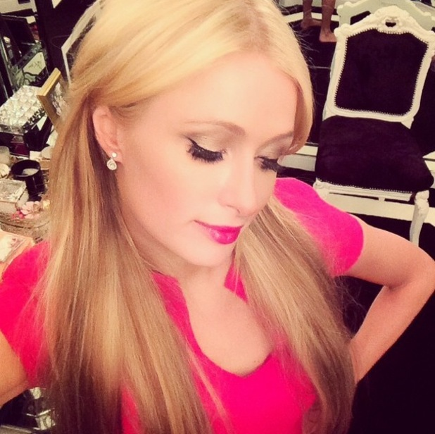 Paris Hilton shows off her new blonde highlights and Barbie pink lipstick in an Instagram picture - 18 September 2014