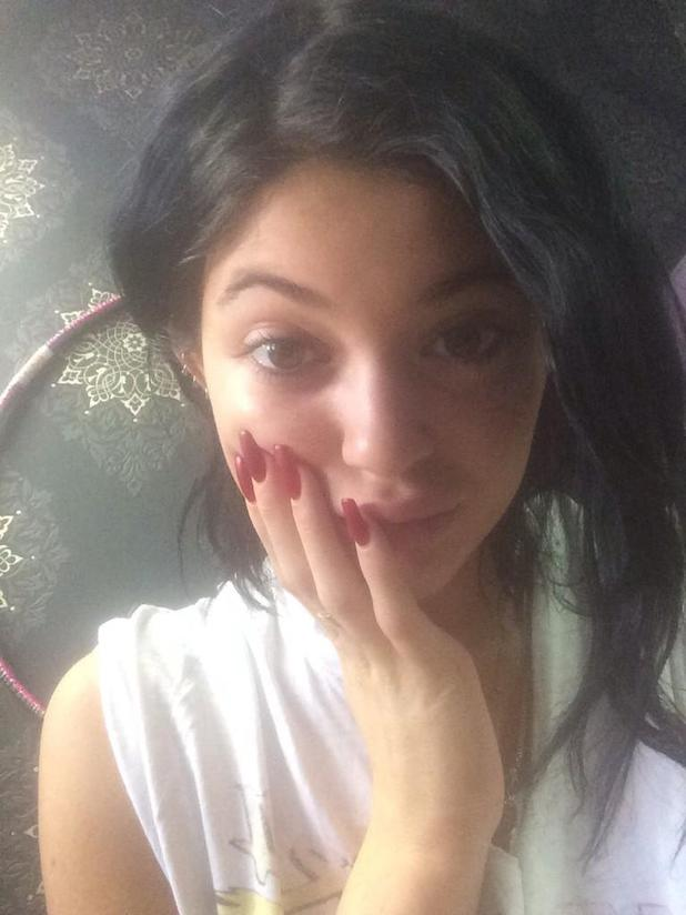 Kylie Jenner shows off her deep red matte manicure in a Twitter selfie - 15 September 2014