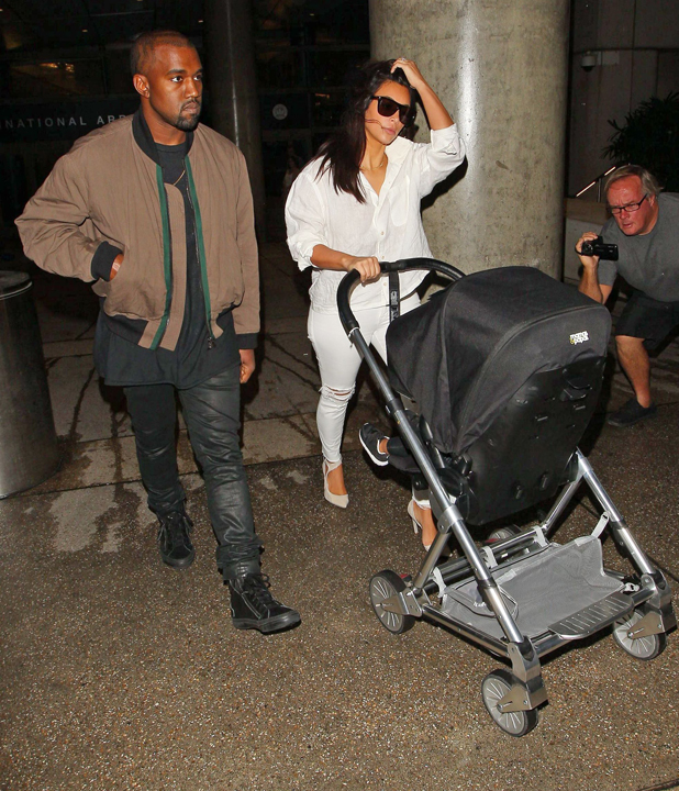 Kim Kardashian and Kanye West at LAX International Airport, Los Angeles, America after Kanye's tour in Australia - 16 Sep 2014
