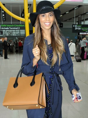 Rochelle Humes arriving at Dublin airport holding phone with Marvin and Alaia's pictures on it, 17 September 2014