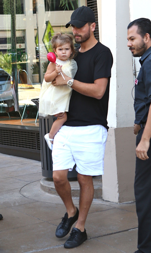 Kourtney Kardashian leaves the American Girl Party at The Grove with her partner Scott Disick and their two children, Mason and Penelope, 14 September 2014