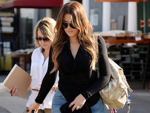 Khloe Kardashian swaps gym clothes for striking thigh high boots
