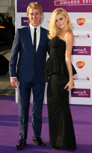 Trent Whiddon and Pixie Lott attends the WellChild Awards at London Hilton on September 22, 2014 in London, England.