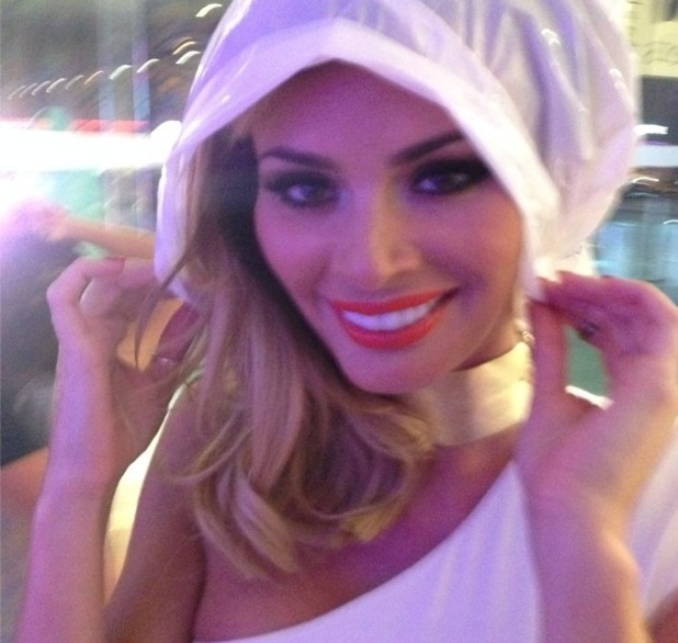 Chloe Sims gets caught in the rain while on a night out in Ibiza, Es Paradis, Ibiza, Spain 25 September
