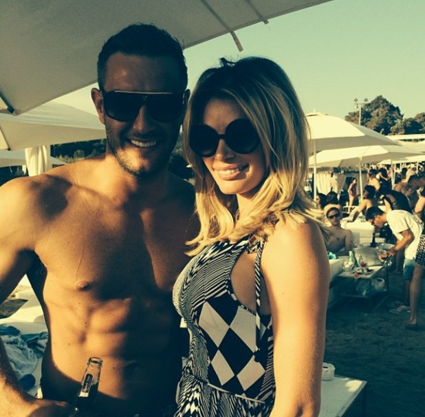 Chloe Sims shows off a new long bob while posing with Elliott Wright in Ibiza, 21 September 2014