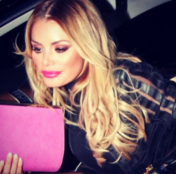 Chloe Sims shows off her blonde, long hair, 2 September 2014