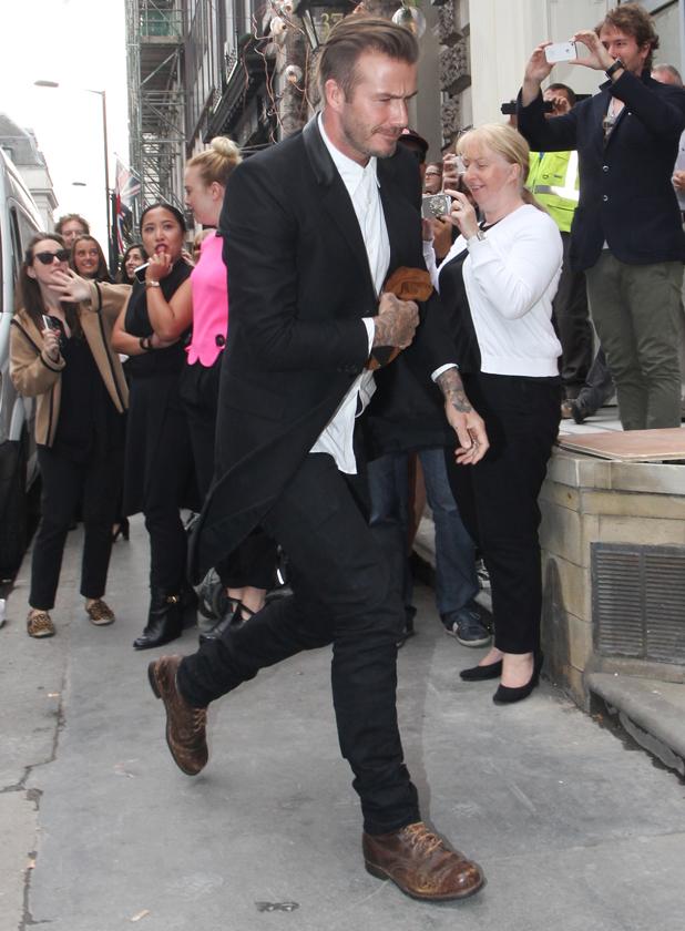 David Beckham arrives at Victoria Beckham's new flagship Dover Street store on September 25, 2014 in London, England.