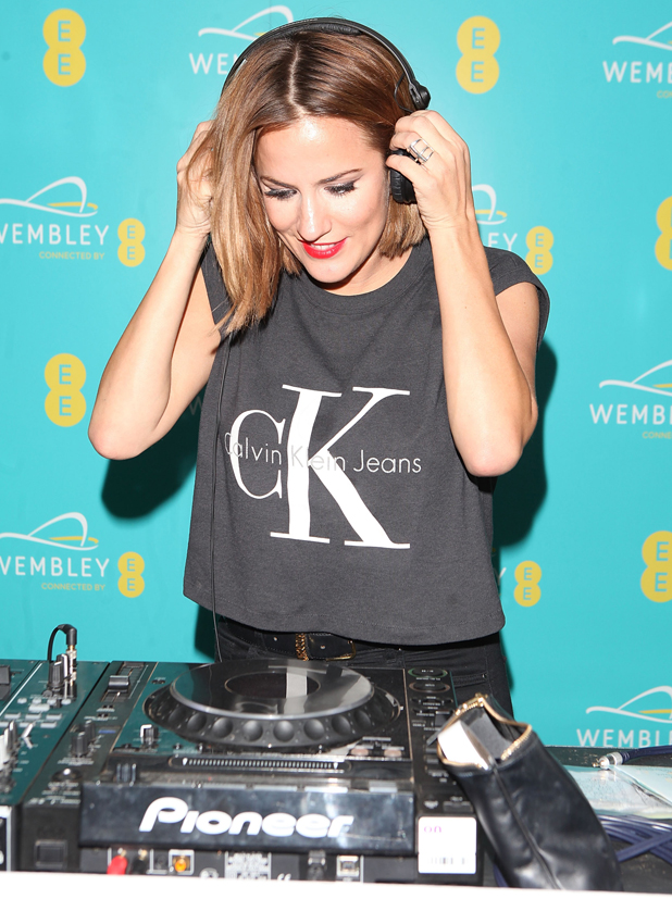 Caroline Flack at Hilton London Wembley on September 23, 2014 in Wembley, England. EE transforms Wembley Arch with a spectacular light show to celebrate their partnership at an event last night.