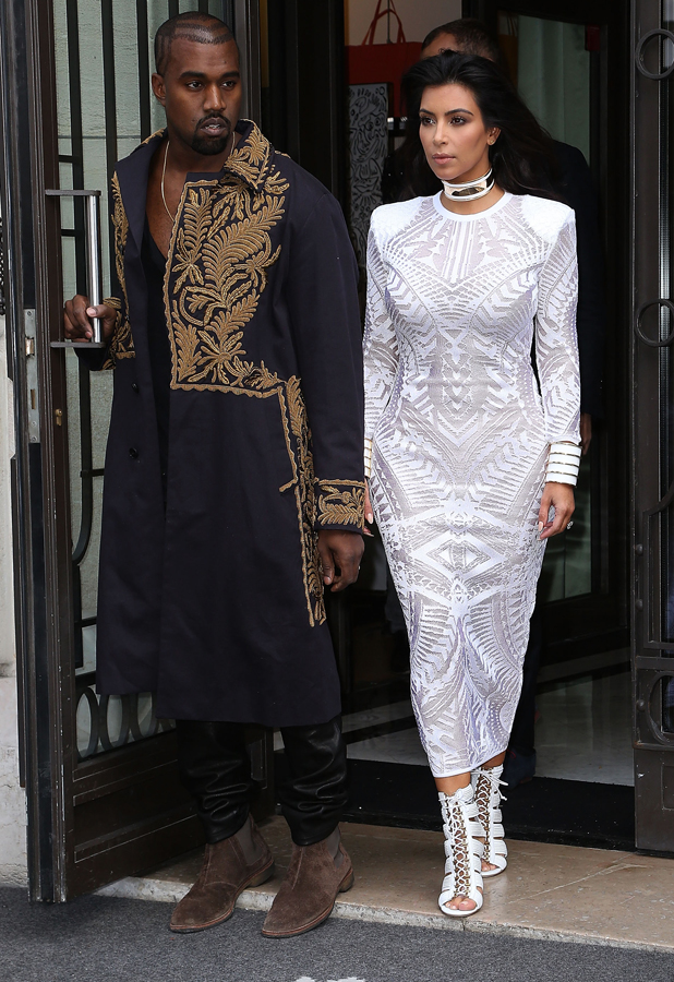 Kim Kardashian and Kanye West arrive to attend the 'Balmain' fashion show at Paris Fashion Week on September 25, 2014 in Paris, France. (Photo by Marc Piasecki/GC Images)