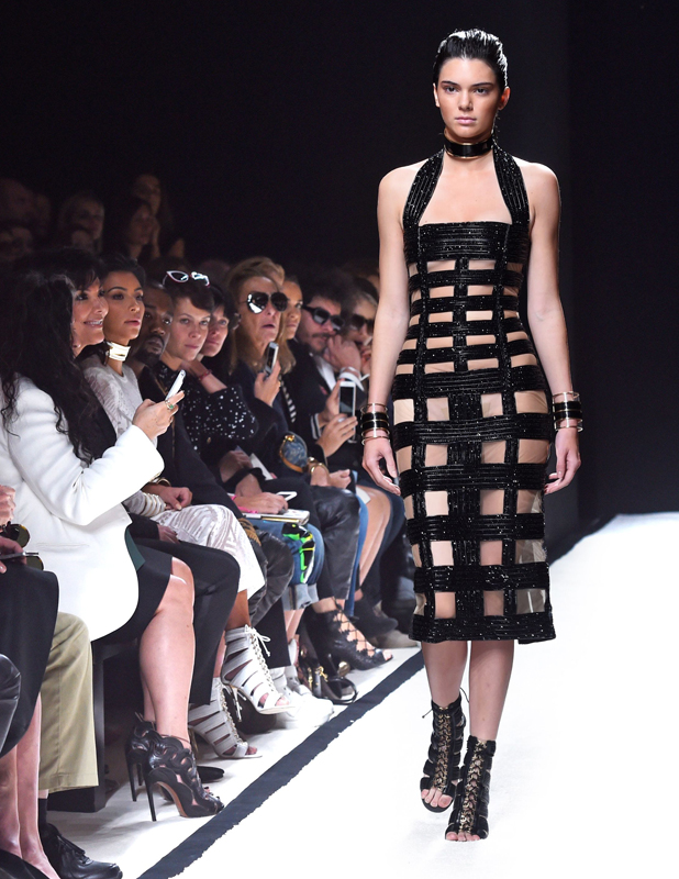 Balmain show, Spring Summer 2015, Paris Fashion Week, France - 25 Sep 2014 Kim Kardashian, Kanye West and Kris Jenner in the front row watching Kendall Jenner on the catwalk