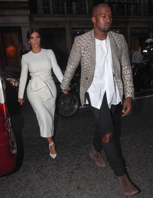 Kim Kardashian and Kanye West leaving Hakkasan restaurant, London, 23 September 2014