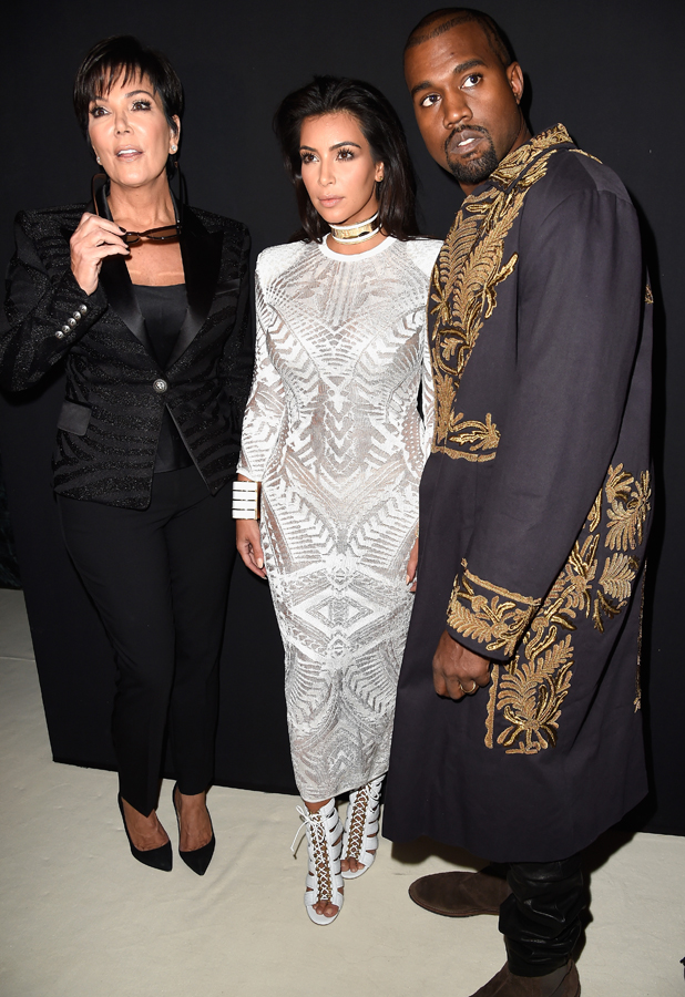 Kris Jenner, Kim Kardashian and Kanye West attend the Balmain show as part of the Paris Fashion Week Womenswear Spring/Summer 2015 on September 25, 2014 in Paris, France. (Photo by Pascal Le Segretain/Getty Images)