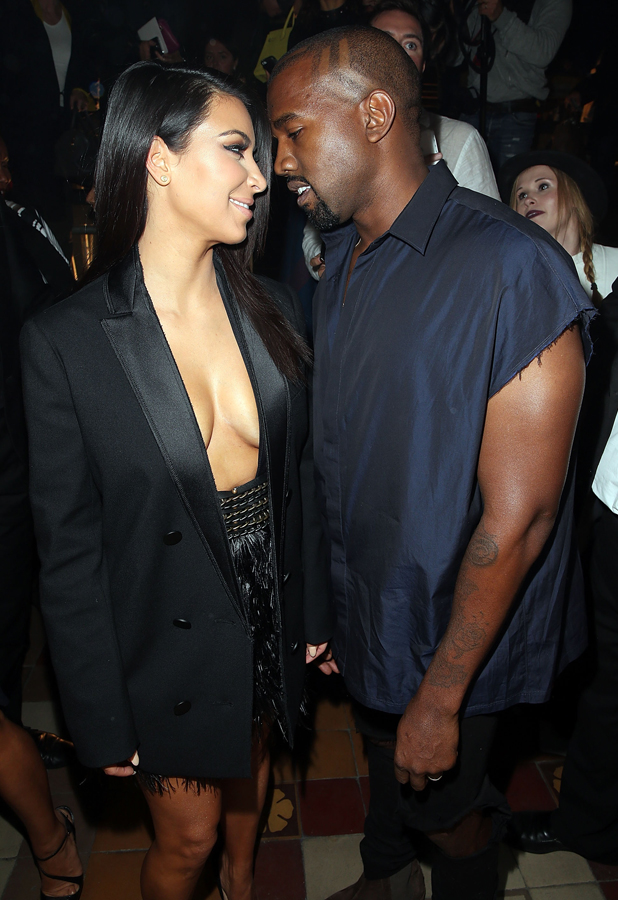 Kim Kardashian and Kanye West attend the Lanvin show as part of the Paris Fashion Week Womenswear Spring/Summer 2015 on September 25, 2014 in Paris, France. (Photo by Rindoff/Dufour/Getty Images)