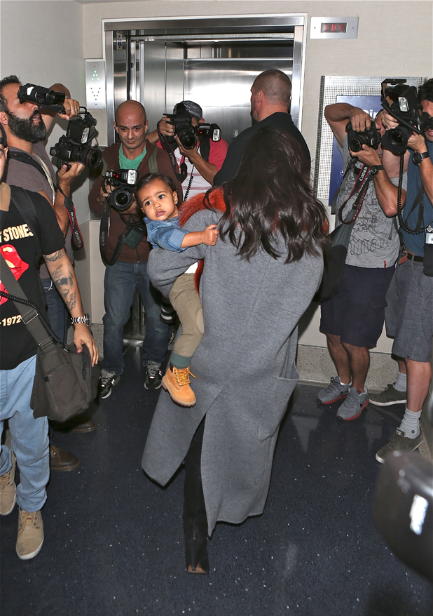 Kim Kardashian and baby daughter North West arrive at Los Angeles International Airport, 22 September 2014