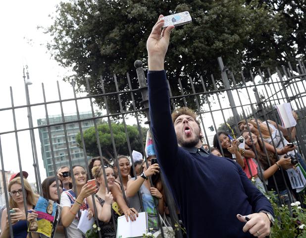 Sam Claflin takes a selfie at 'The Riot Club' film photocall, Rome, Italy - 22 Sep 2014