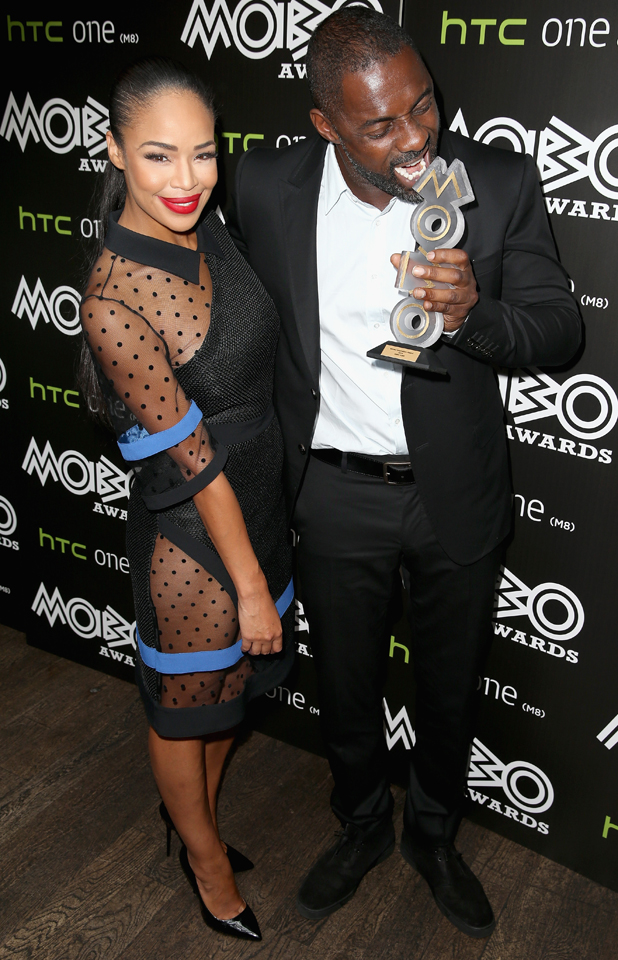 Presenter Sarah-Jane Crawford and Actor Idris Elba attend the MOBO Awards nominations launch at Ronnie Scott's Jazz Club on September 23, 2014 in London, England. (Photo by Chris Jackson/Getty Images)