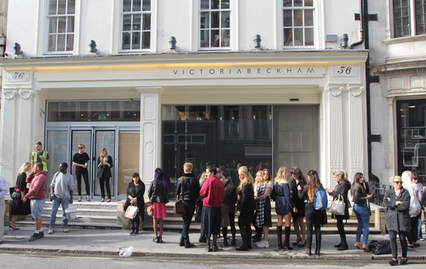 Shoppers queue outside Victoria Beckham's new London store ahead of its opening, 25 September 2014