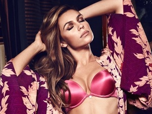 Abbey Clancy flaunts figure while modelling sexy pink lingerie