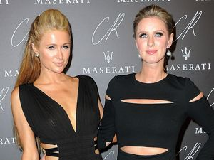 Paris & Nicky Hilton stun in smouldering black dresses at fashion party