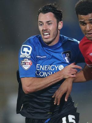 Cardiff City's Tom Adeyemi and Bournemouth's Adam Smith compete for the ball 23 Sep 2014